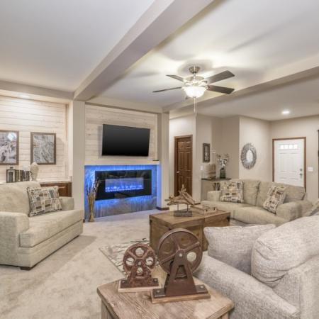 Manufactured home with a large living room and fireplace.
